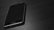 black-and-white, smartphone, table