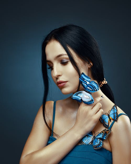 Woman Wearing Blue Spaghetti-strap Top