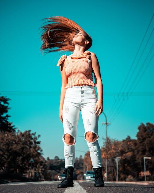Бесплатное стоковое фото с активный отдых, взмах волосами, волос, выражение лица