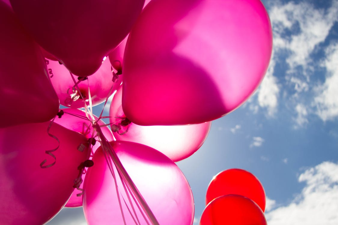 Pink and Red Balloons during Daytime