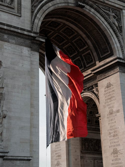 Triumphal Arch decorated with flag of France