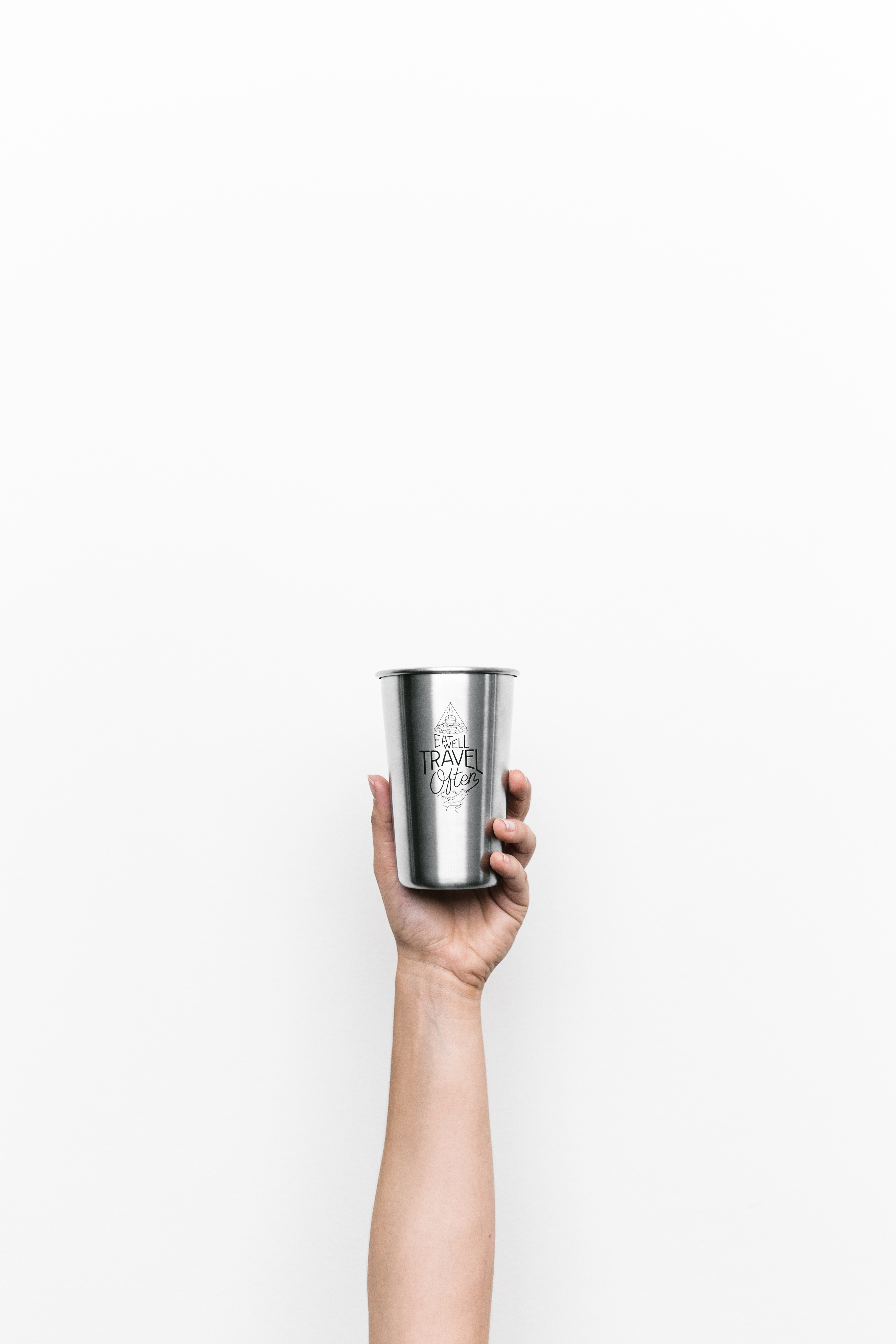 Person Holding Gray Cup