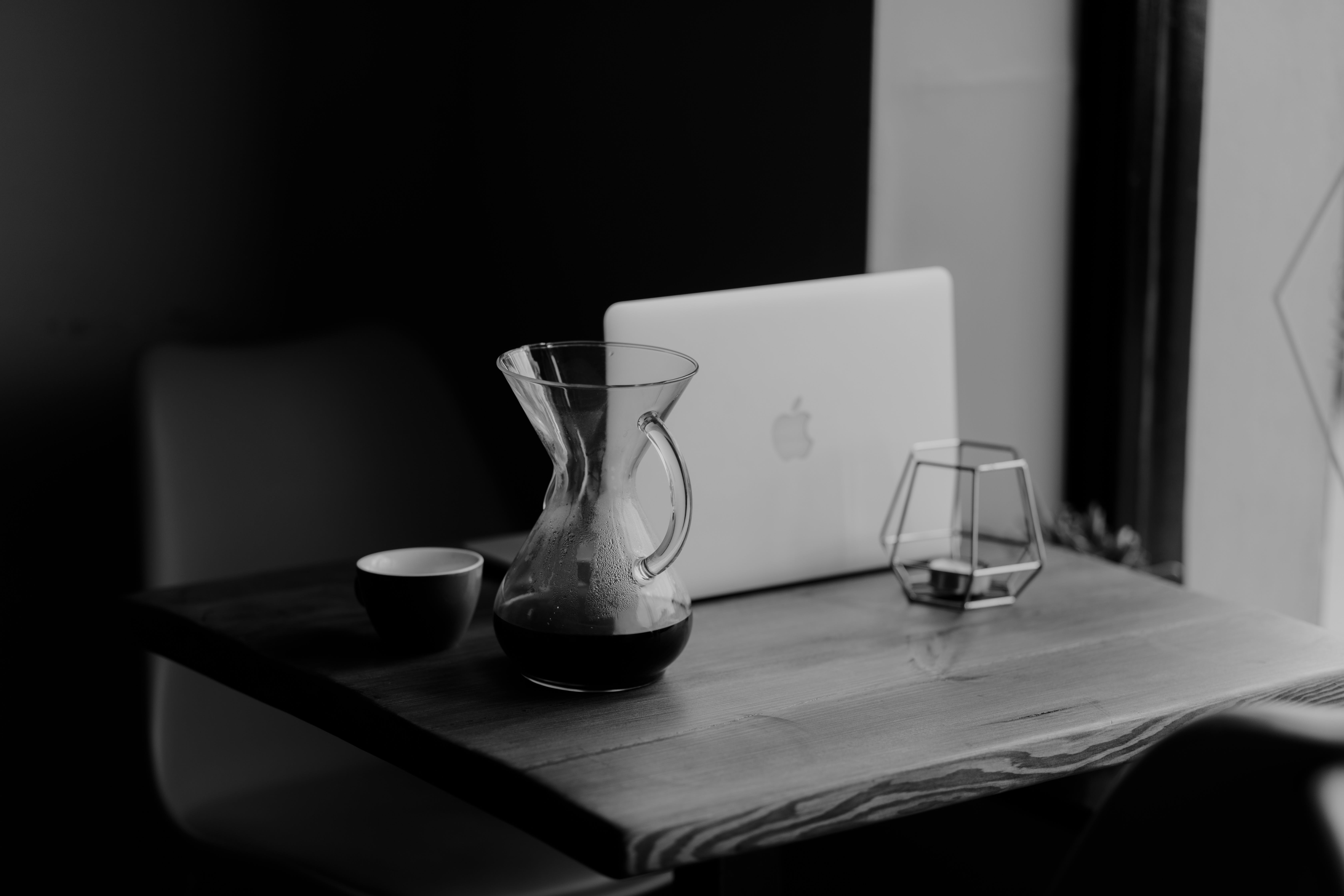 Macbook White Beside Clear Glass Pitcher