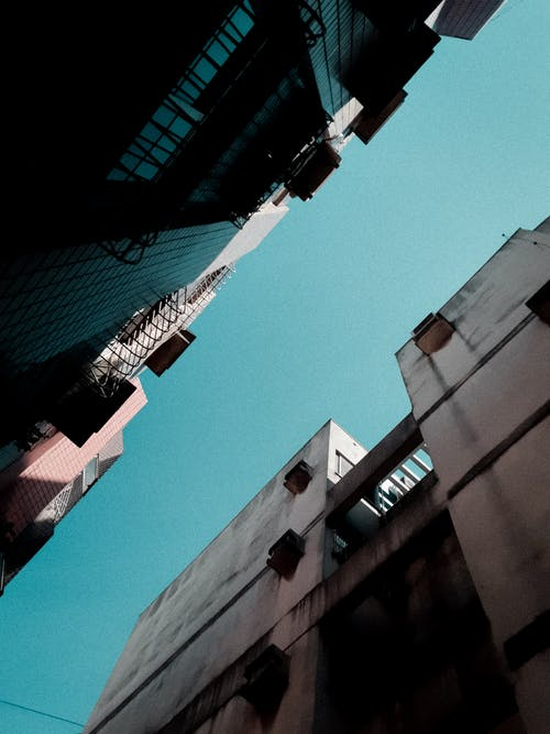 Low-angle Photography of Buildings Under Blue Sky