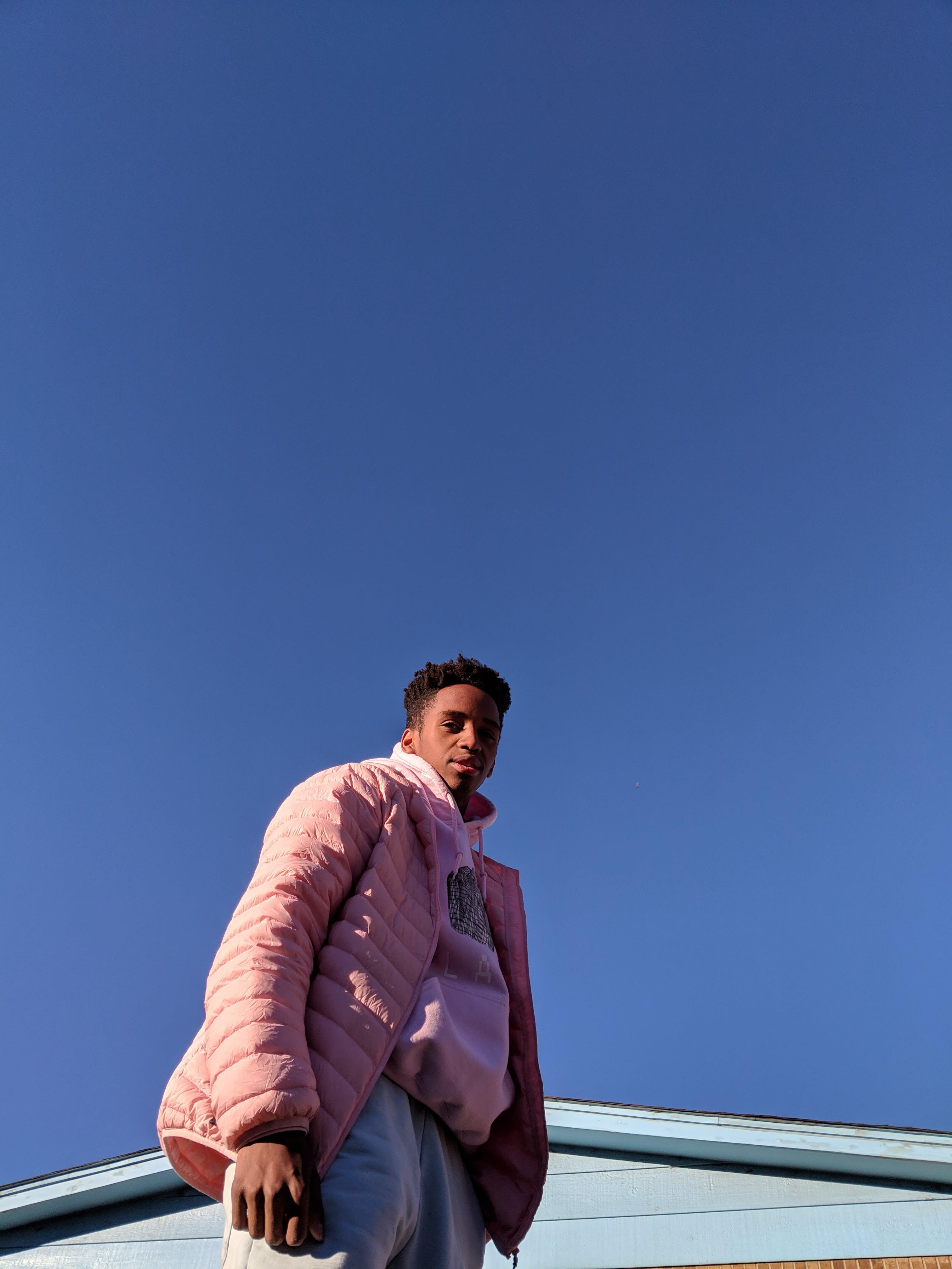 Man Wearing Pink Jacket