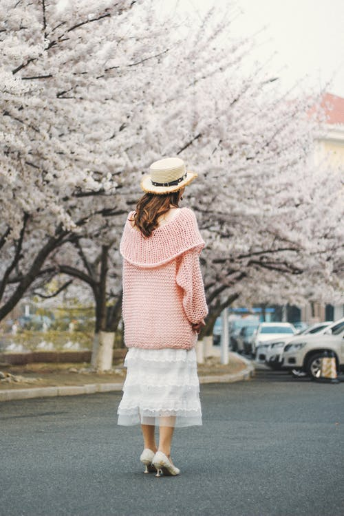 Standing Woman Wearing Pink Jacket and White Dress