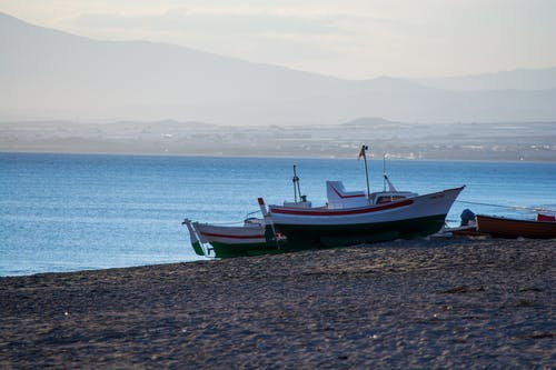 Free stock photo of beach, by the sea, fishing boats