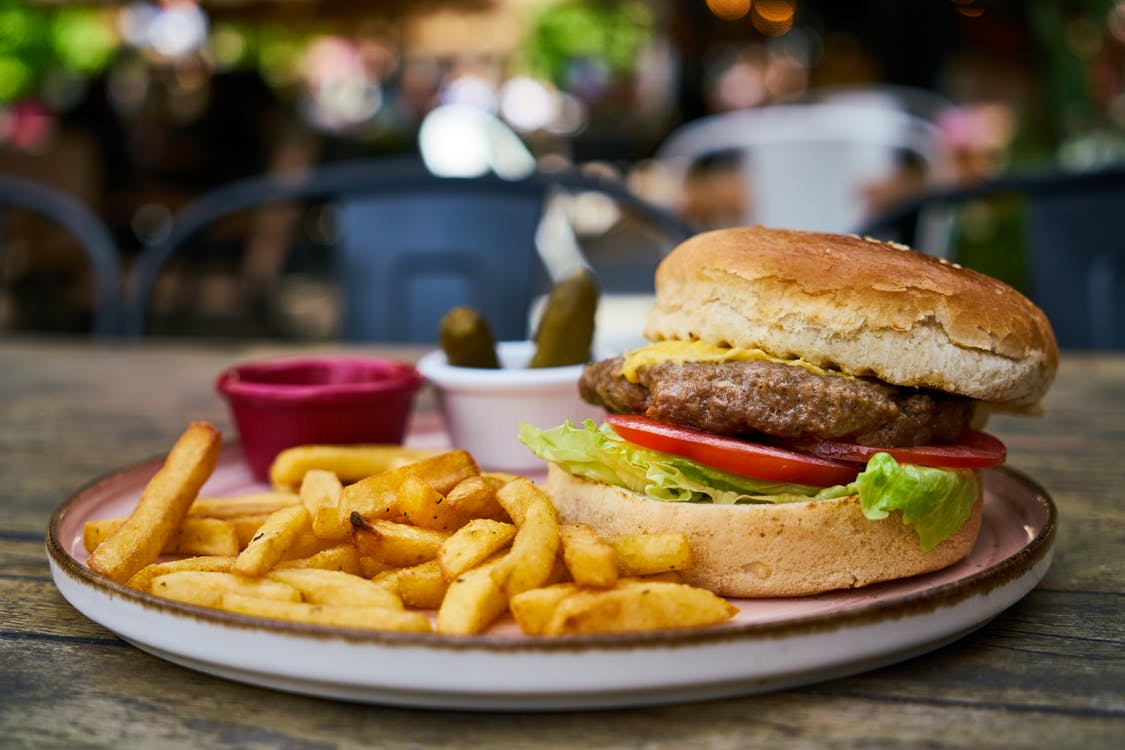 Burger and Fries on White Plate