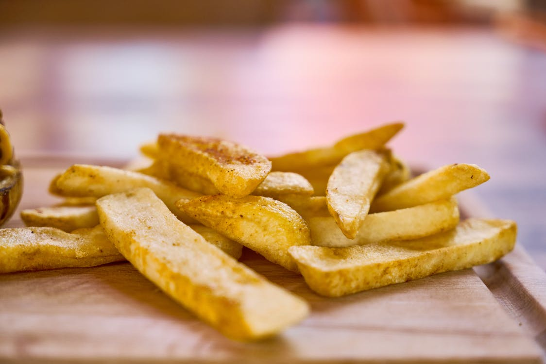 Fries on Brown Table