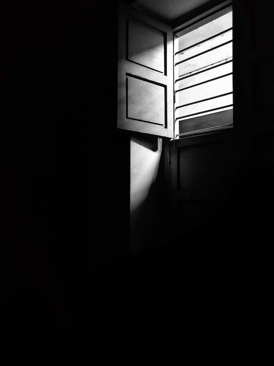 Grayscale Photo of Window Opened