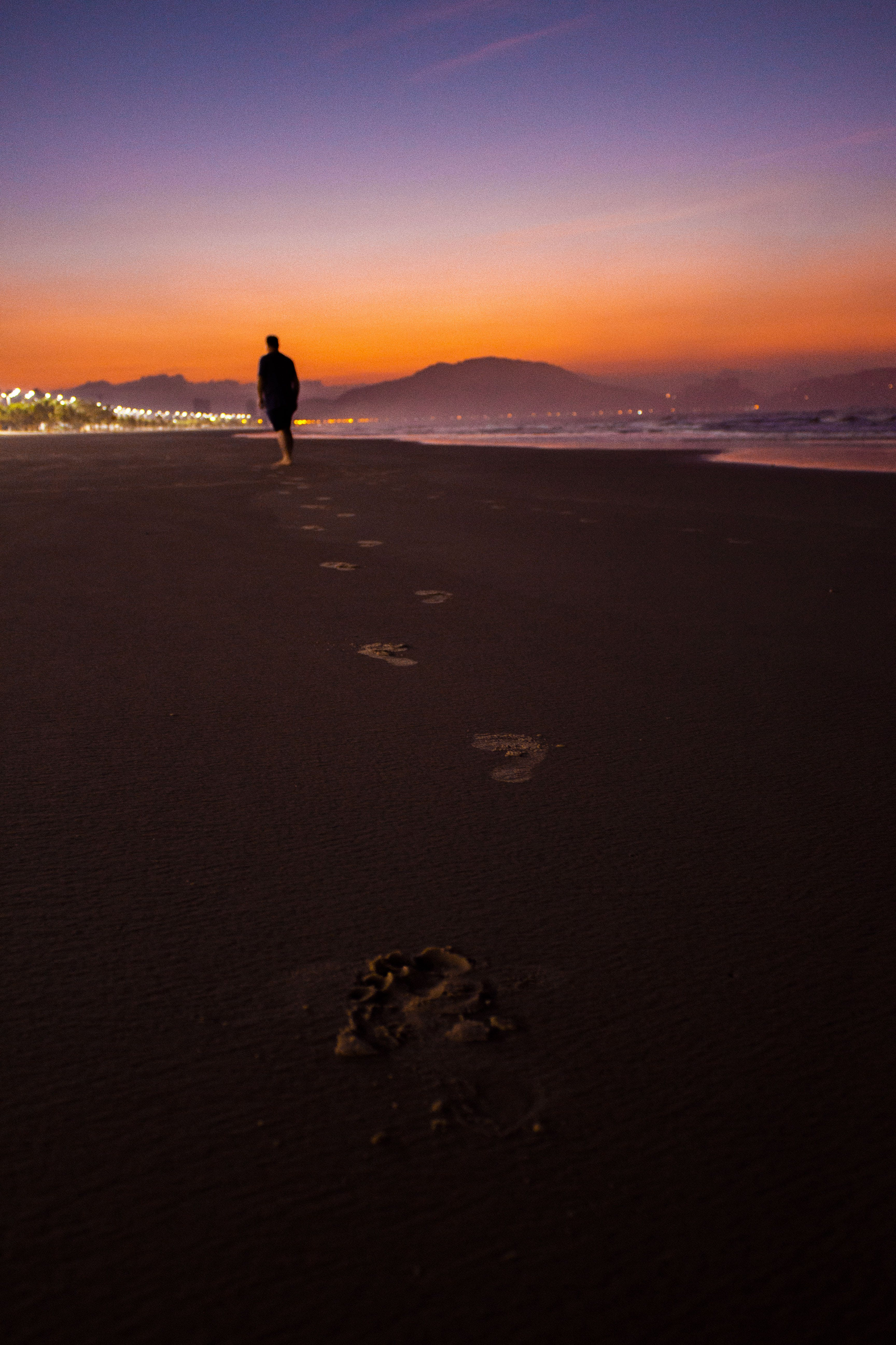 Silhouette Photography of Person Walking Beside Beach