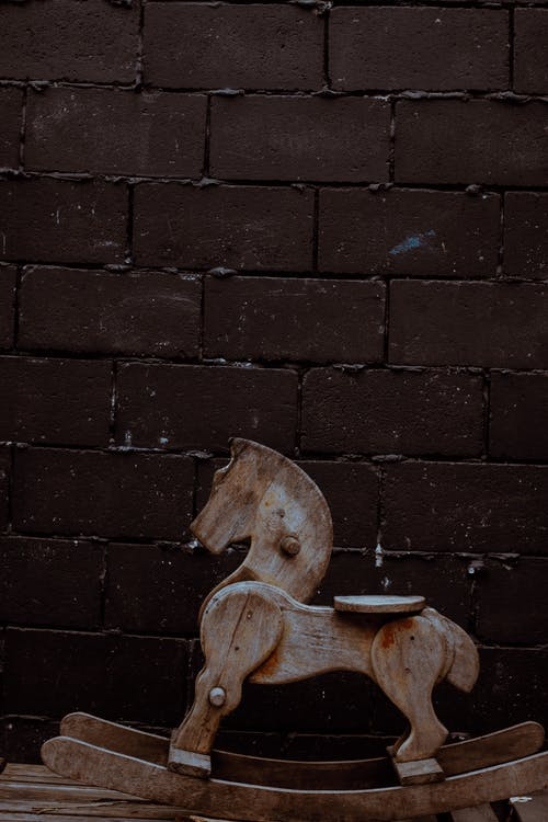 Shallow Focus Photo of Brown Wooden Rocking Horse