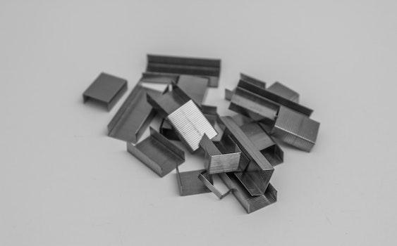 Free stock photo of black-and-white, dark, stapler, blur