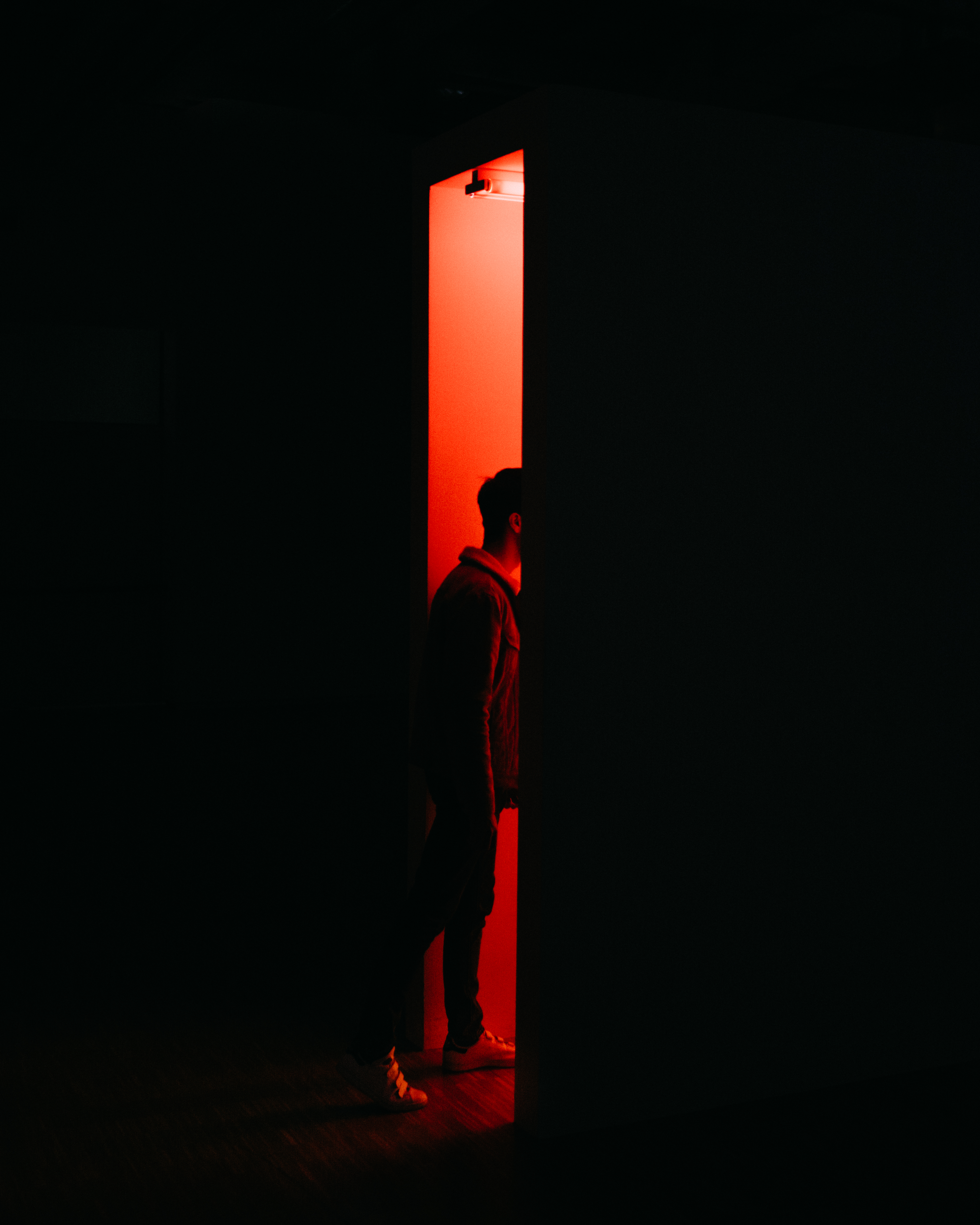 Person Standing on Opened Doorway