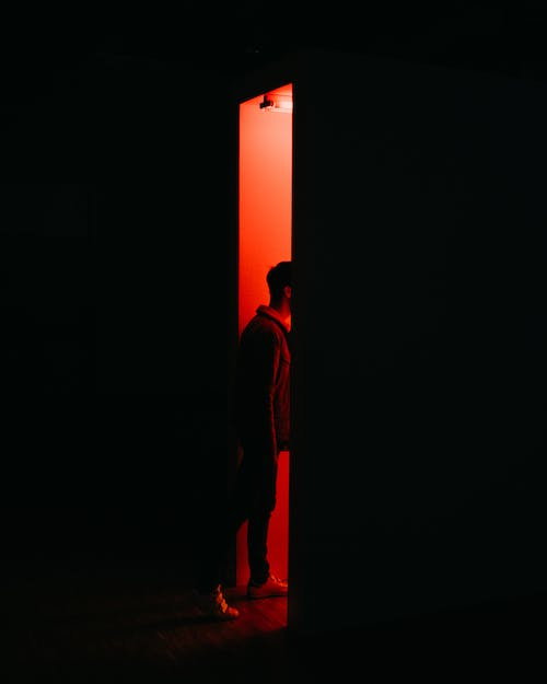 Person Standing on Opened Doorway