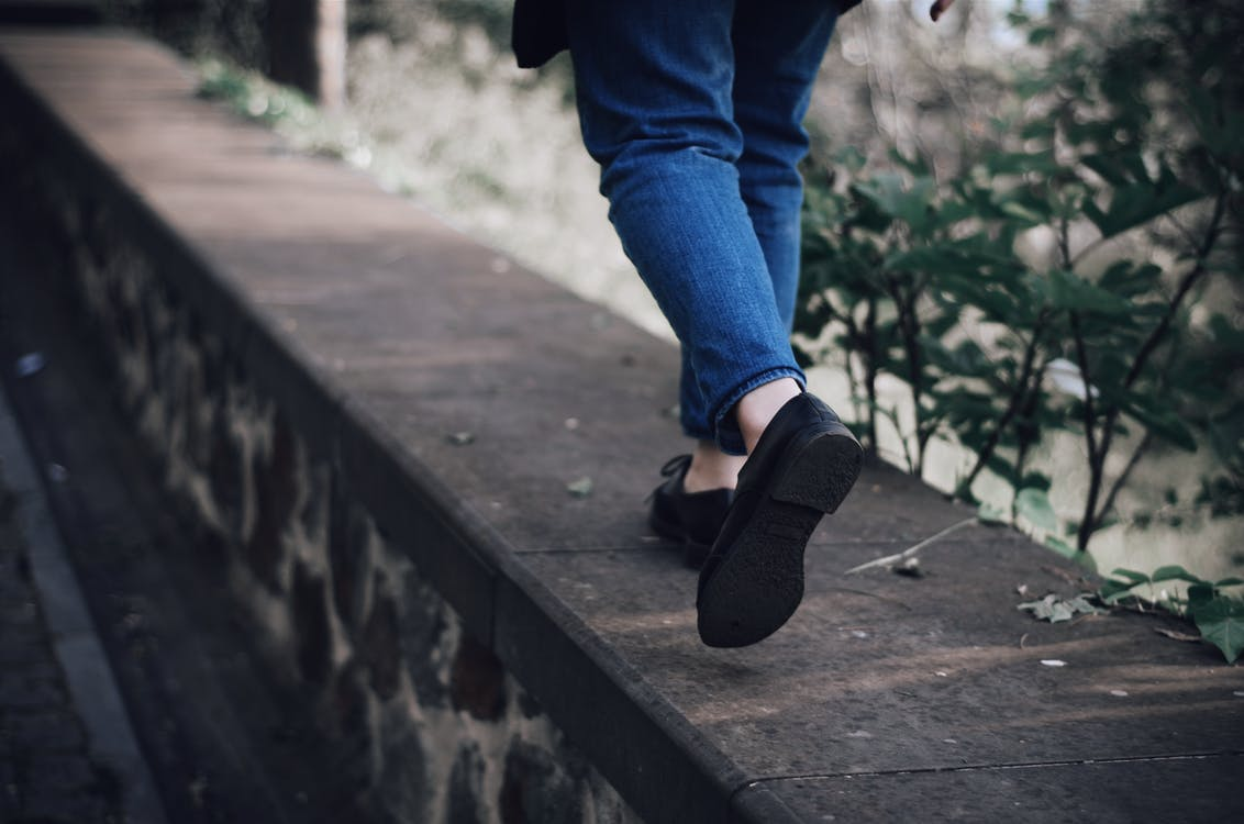 Person Walking on Footpath