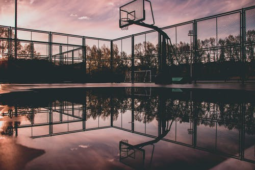Basketball Hoop Reflecting on Water