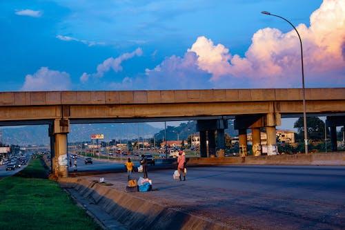 Free stock photo of black people, bridge, clouds