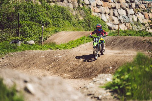 Photo of Man Riding Dirt Bike