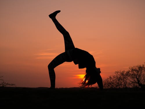 Silhouette Photo of Woman Doing Yoga during Golden Hour