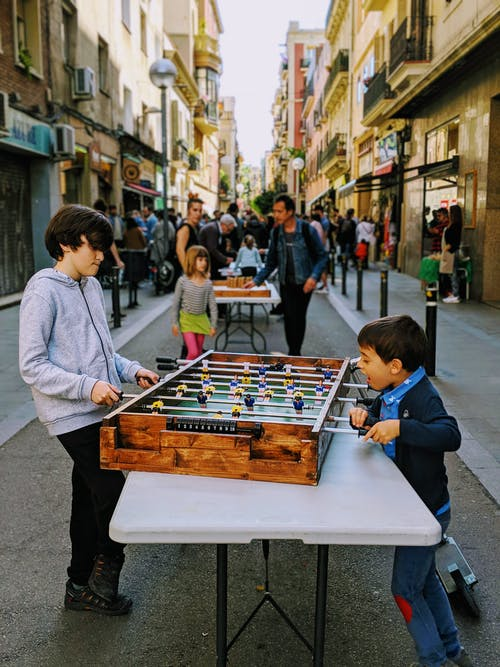 Two Kids Playing On Table