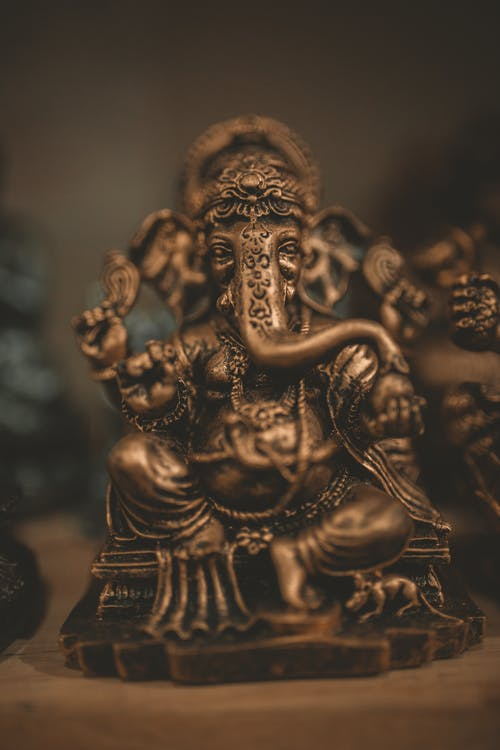 Brass-colored Lord Ganesha Figurine