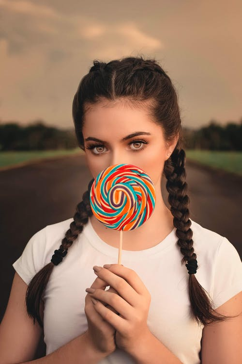 Woman Holding Lollipop