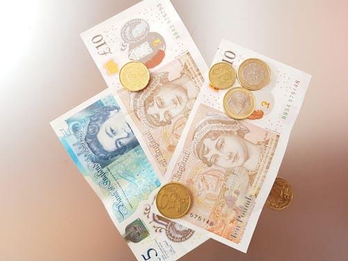 Gratis stockfoto met bankbiljetten, bonzen, geld