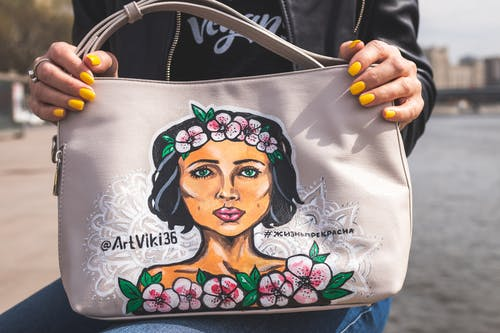 White and Pink Female Portrait-printed Handbag