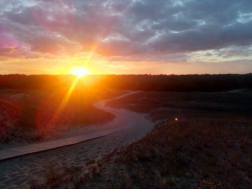 Бесплатное стоковое фото с вечер, дорога, дорожка, закат