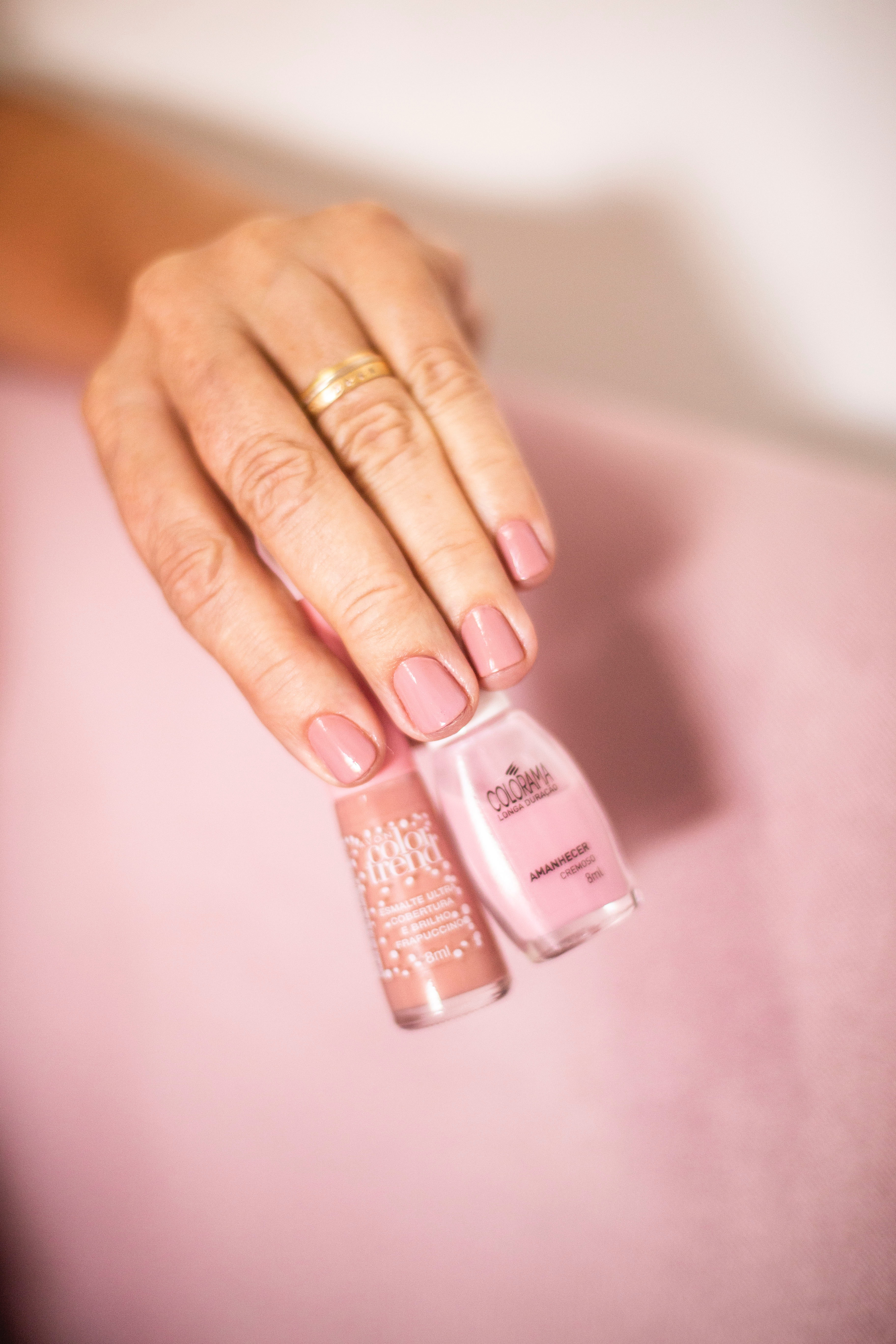 Person Holding Nude Color Nail Polish Free Stock Photo