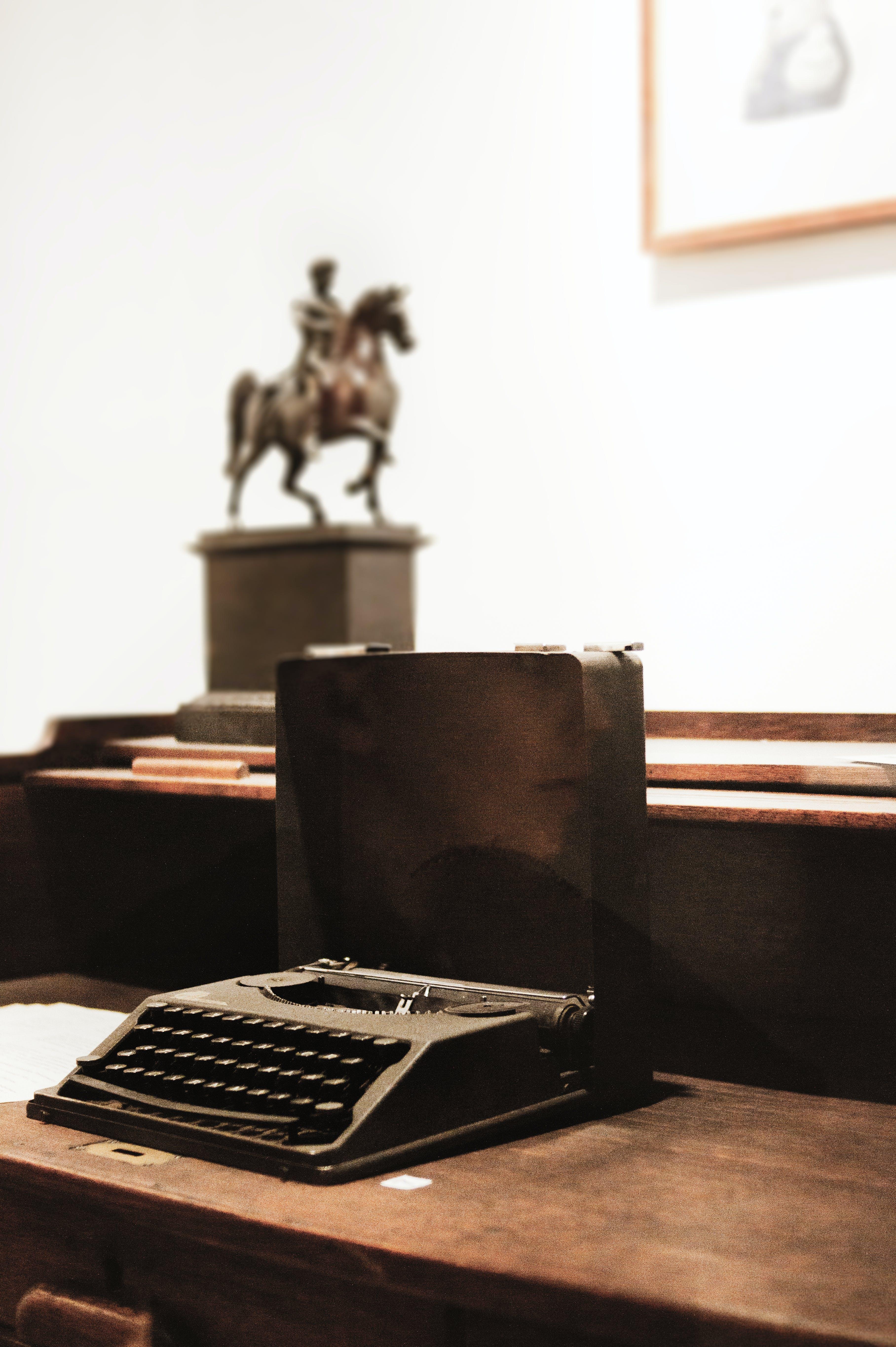 Black Typewriter on Brown Wooden Surface