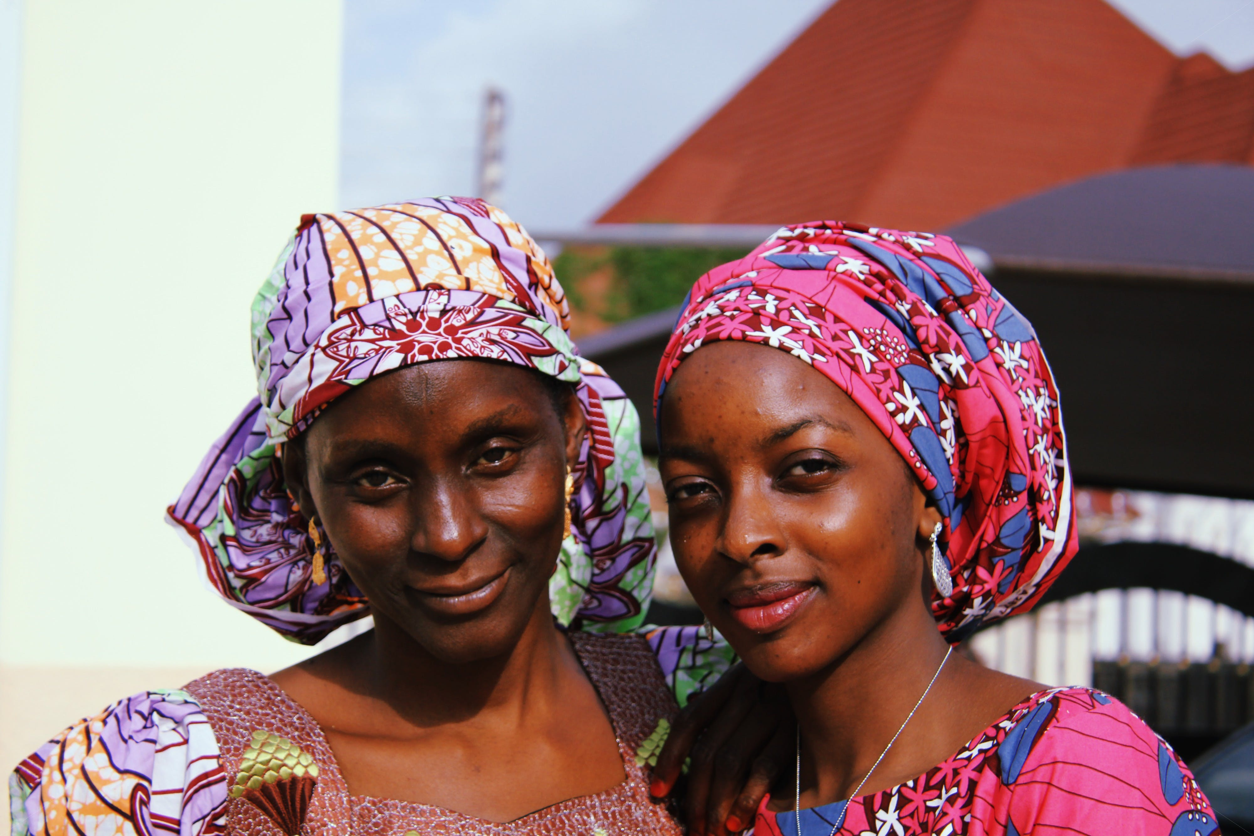 Two Women in Traditional Dresses Posing for Photo