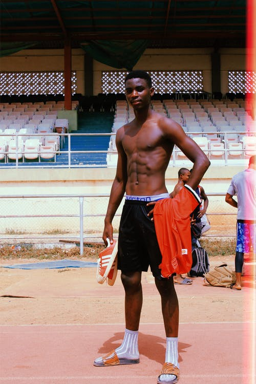Shirtless Man Posing After A Game