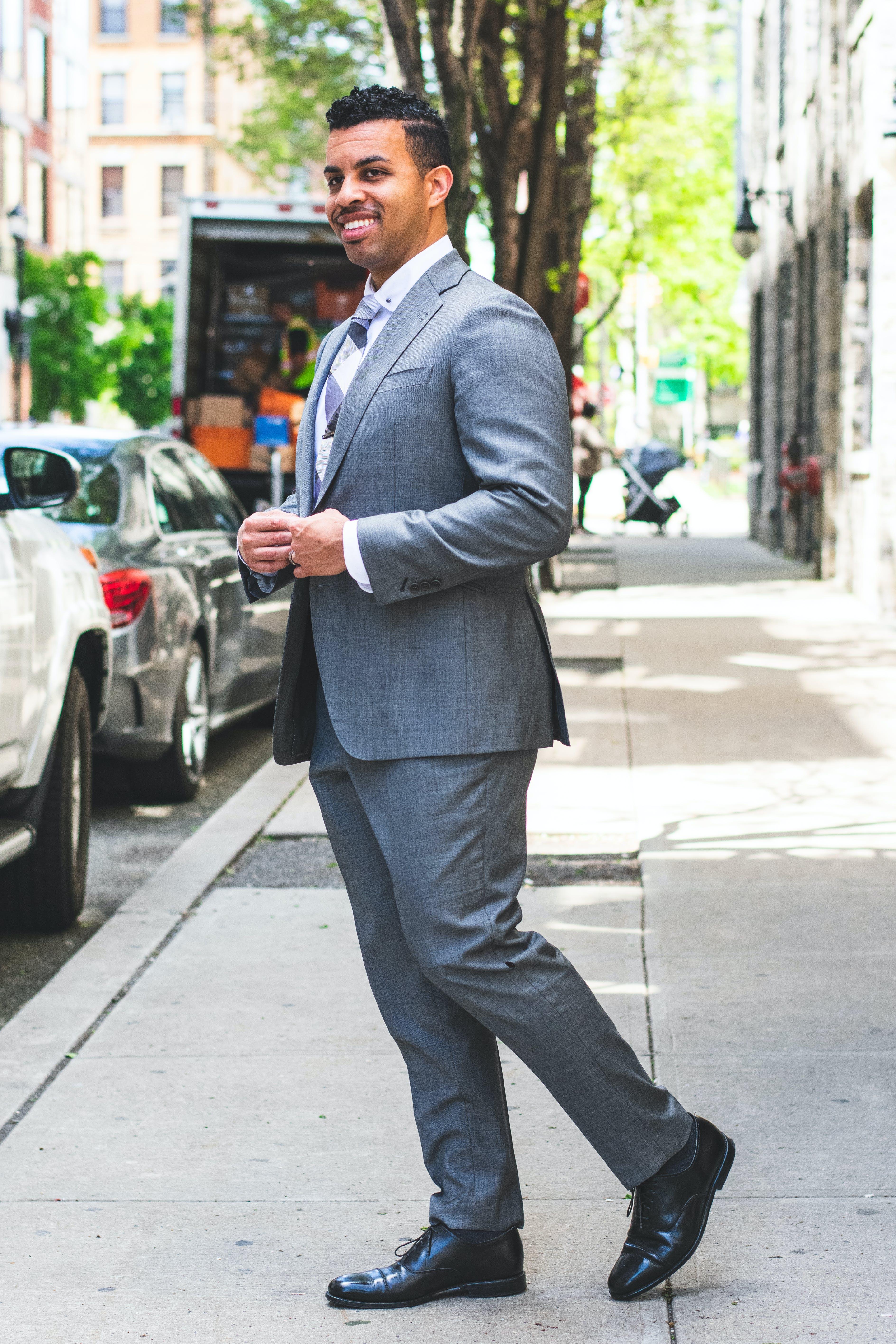 Smiling Man In Grey Suit Standing On Sidewalk
