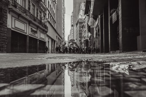 Grayscale Photography Of People Walking Near Street