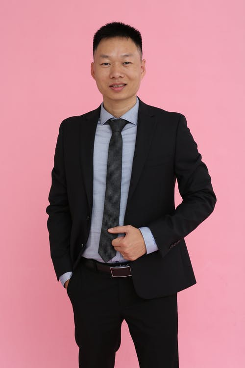 Free stock photo of asian man, black suit, facial expression, fashionable
