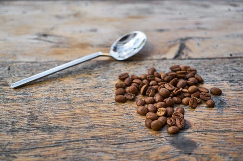 Coffee Beans Beside Tea Spoon