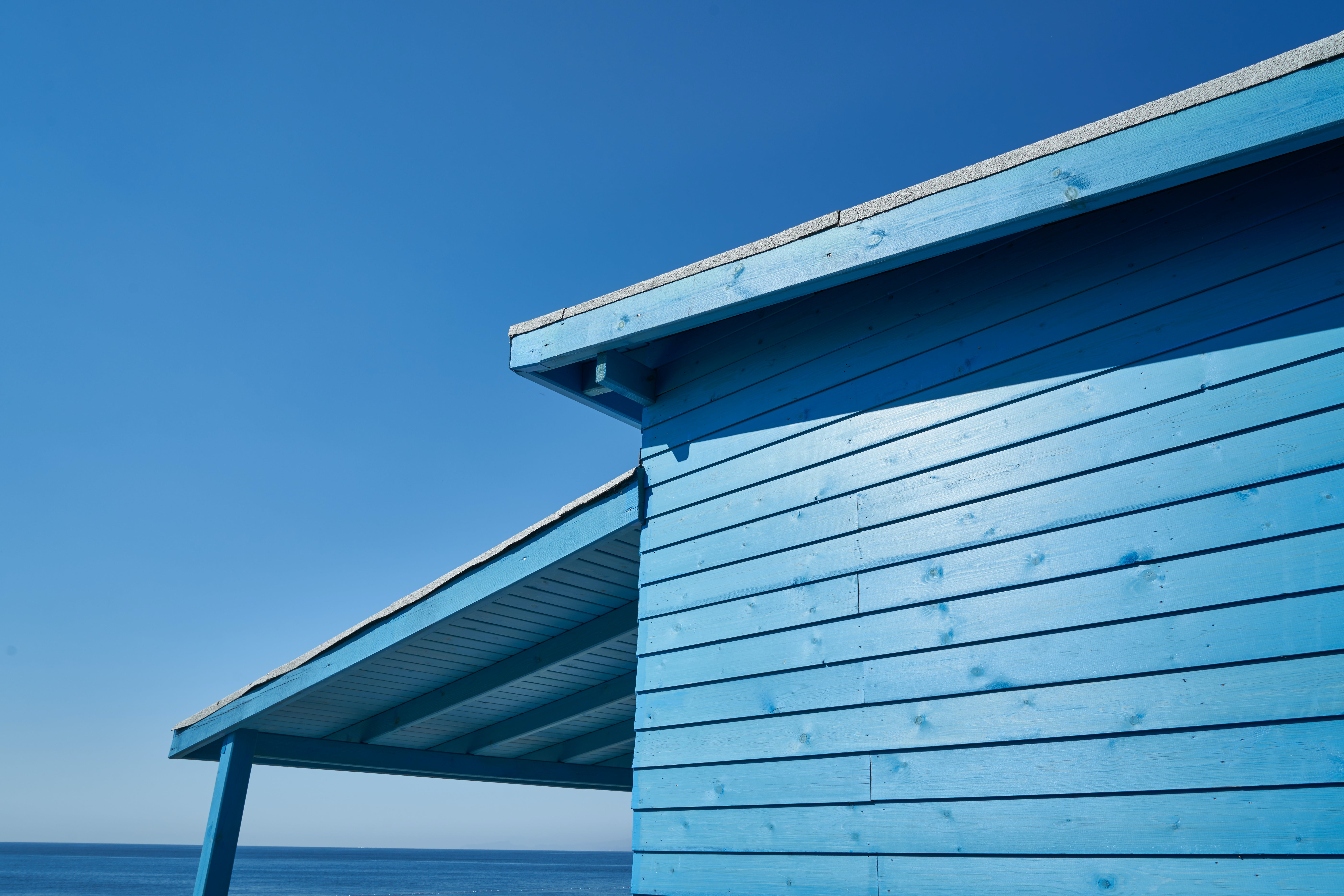 Blue Wooden House Under Blue Sky