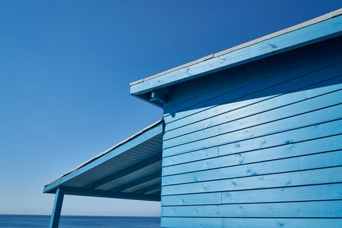Blue Wooden House Under Blue Sky