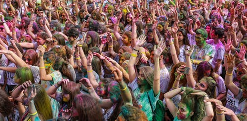 People Covered With Colored Powders
