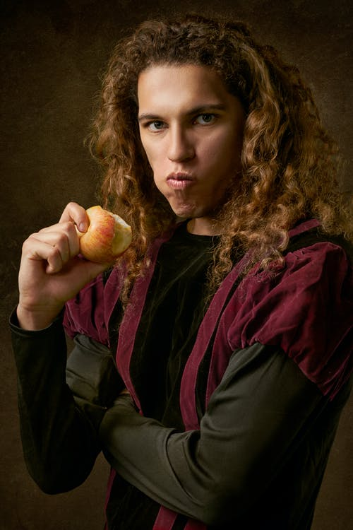 Person Holding Bite of Apple