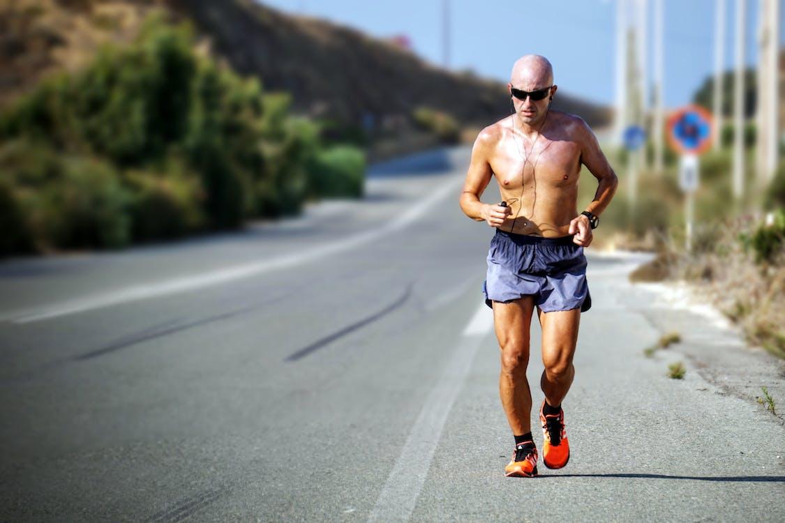 Man Running Beside Street
