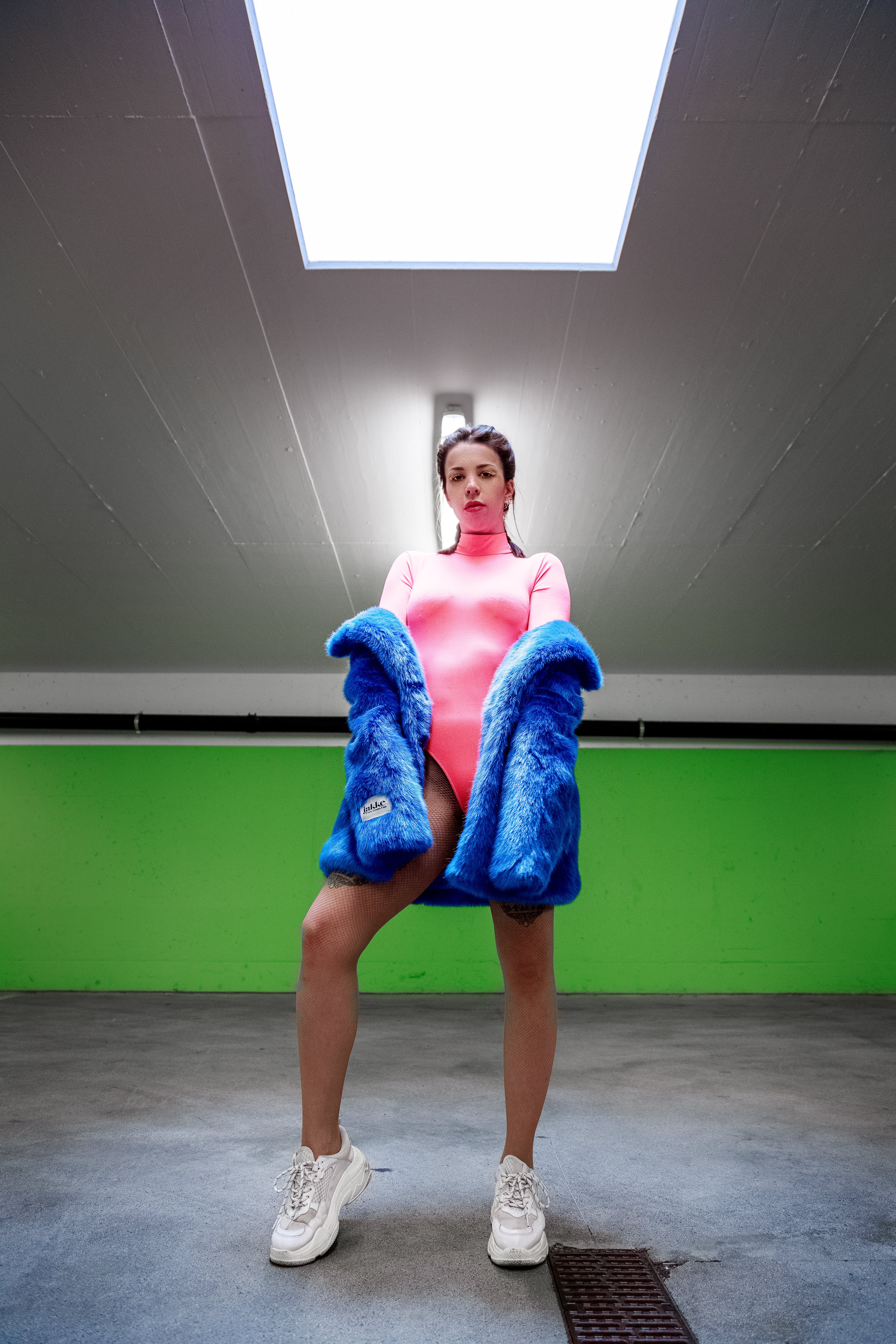 Woman Wearing Pink Bodysuit With Blue Coat