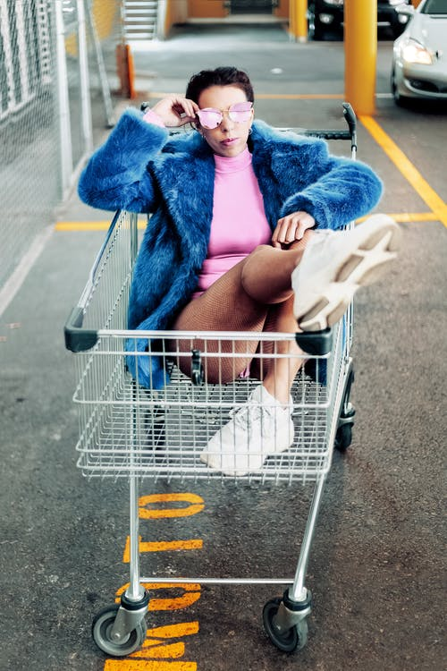 Woman On Shopping Cart