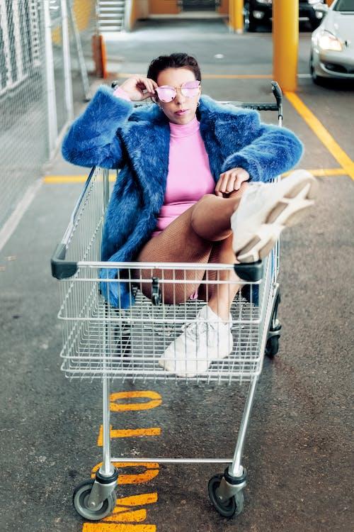 Woman On Shopping Cart