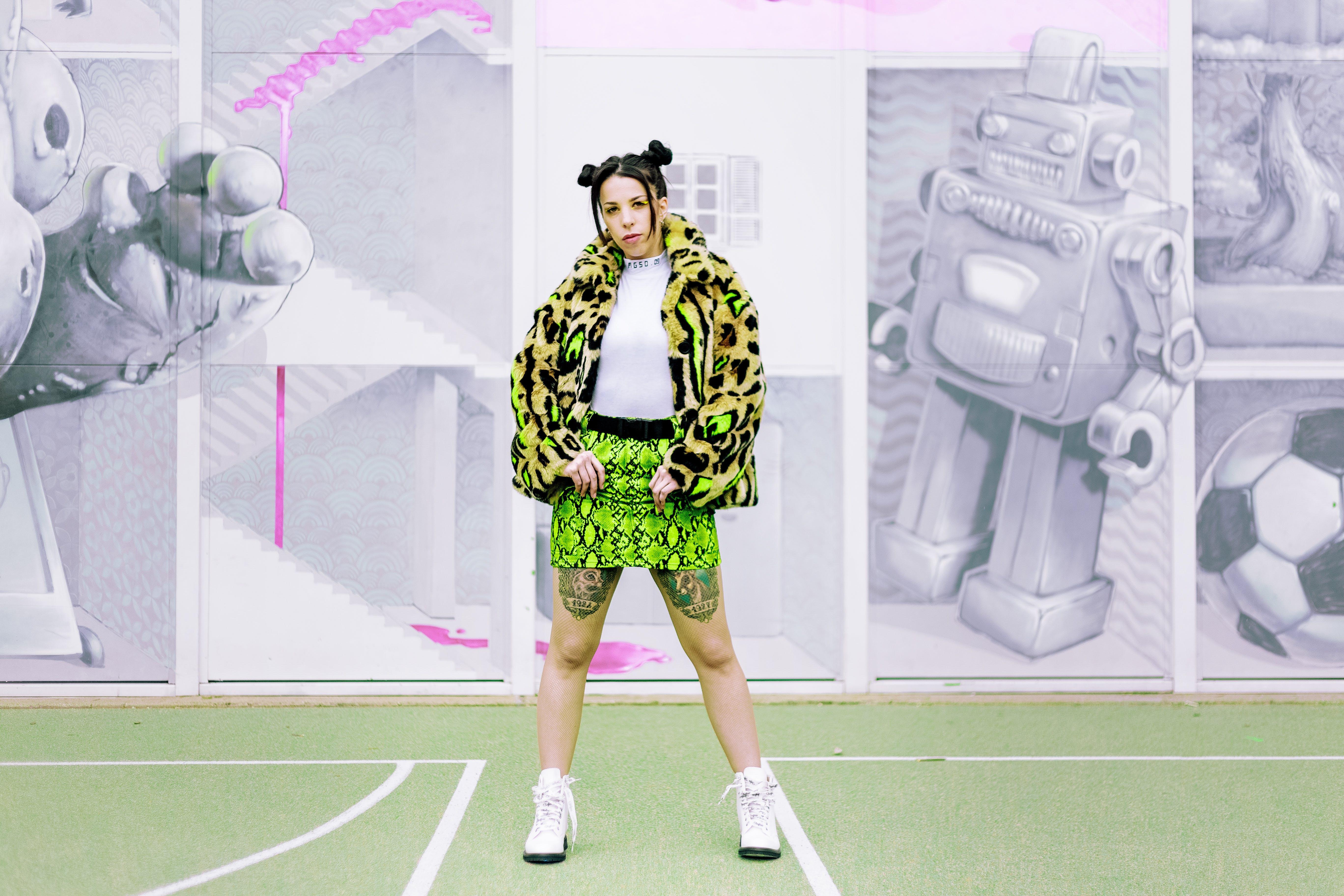 Woman Wearing Coat With Green Mini Skirt