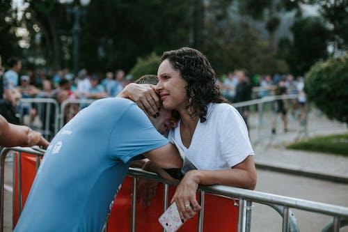 Woman Hugging Man Wearing Blue Crew Neck Shirt
