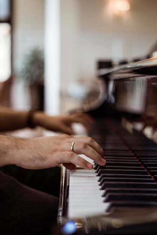 Person Wearing Ring Playing Piano
