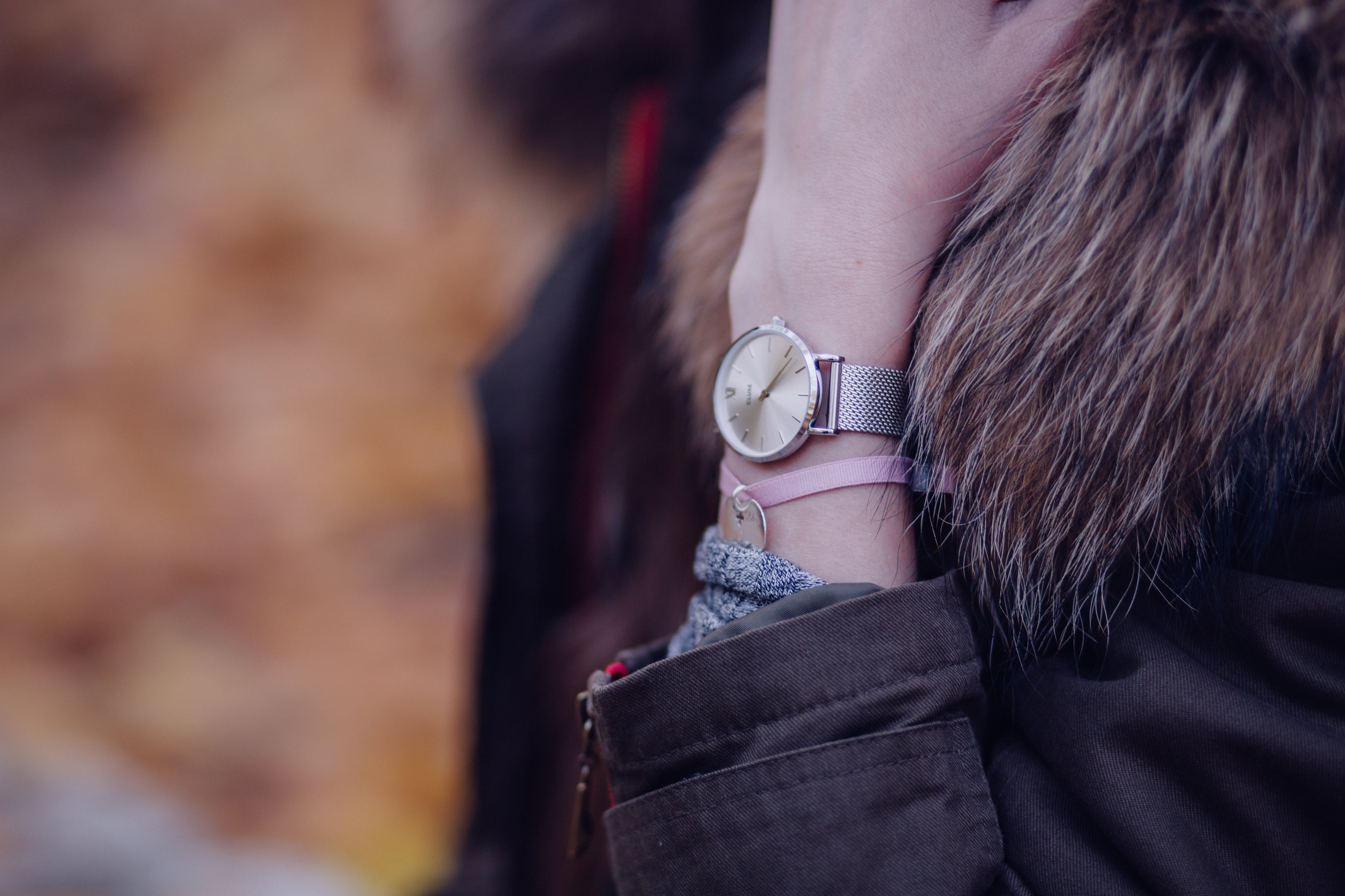 Woman in Brown Parka Jacket With Gold Round Analog Watch